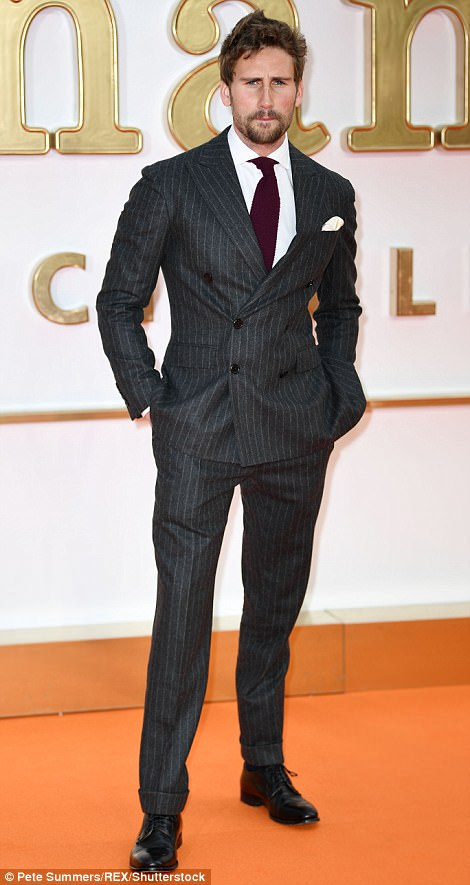 Hunky: MeanwhileEdward Holcroft certainly had his female fans swooning as he appeared on the carpet in a Polo Ralph Lauren dark grey pinstripe wool double breasted suit, white cotton shirt, purple cashmere tie and black leather dress shoes