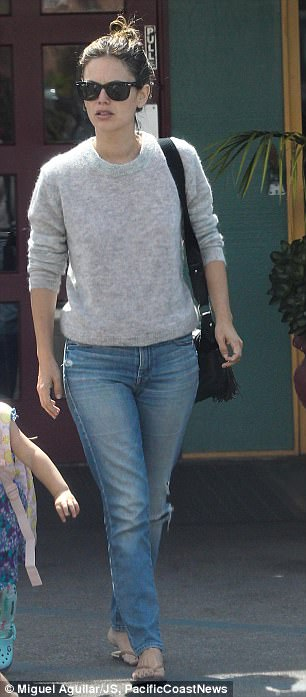 Homeward bound: She sported a pair of casual distressed blue denim jeans and brown flip flops as she left the restaurant