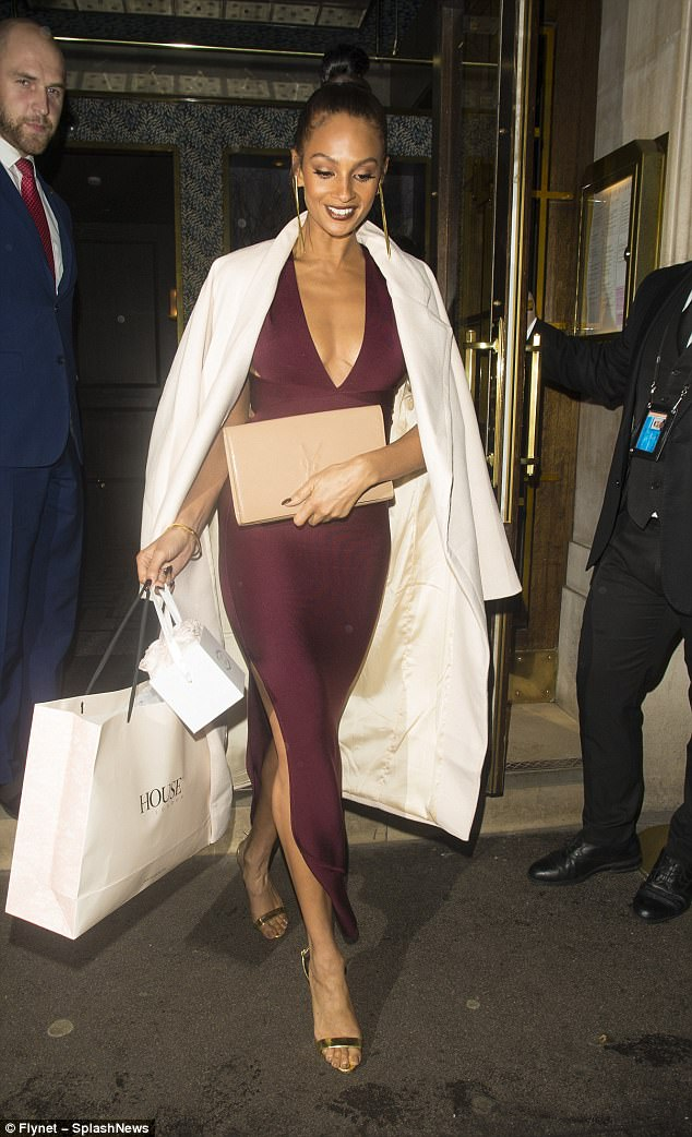 Flawless: Alesha accessories her look with gold chunky strapped heels and a nude envelope clutch