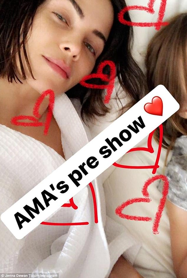 Getting ready:The mother-of-one offered followers a behind-the-scenes look, sharing a photo of her in a robe besides her daughter with the caption 'AMAs pre-show'