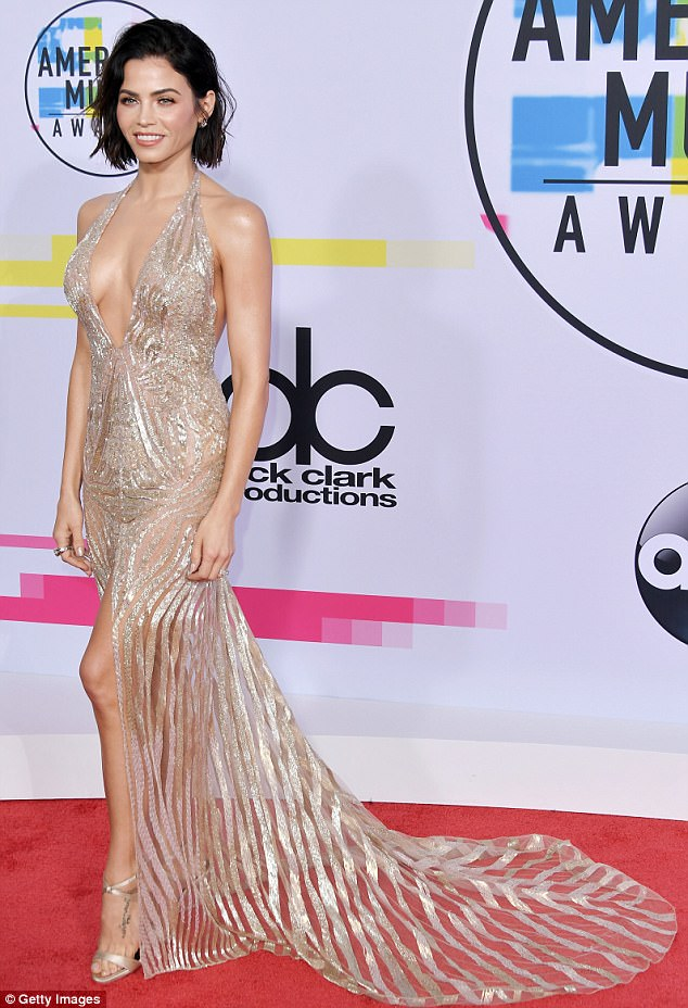 Dare to bare: The gown also revealed a healthy amount of Jenna's toned legs with a ultra-high slit and semi-transparent skirt