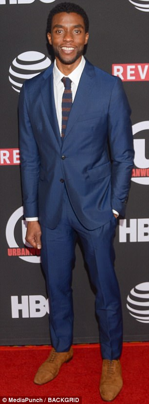 Style guys! Josh Gad sported a handsome blue-violet ensemble with patterned shirt while lead Chadwick Boseman sported suede kicks, a sharp blue suit and striped tie