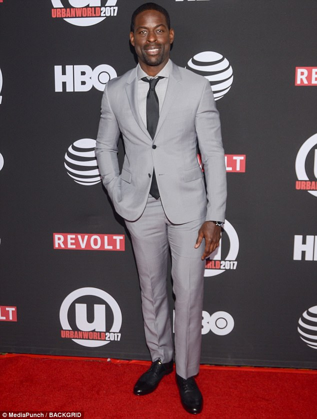 Well suited! Sterling K Brown was dapper in an ash grey suit with black tie and matching kicks