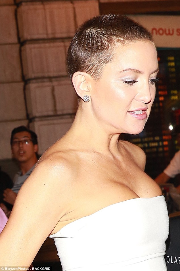 A close shave: Her buzzcut was one again on display during the outing