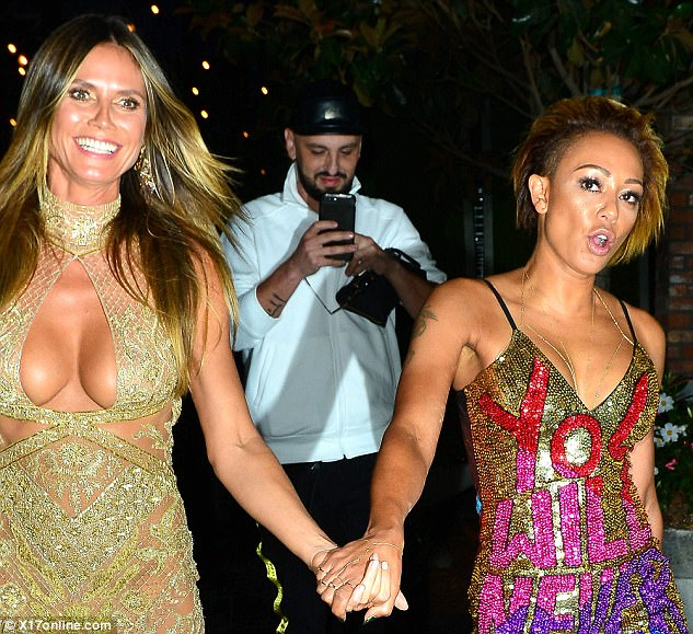 Friends: Mel B and Heidi Klum, both judges on America's Got Talent, arrived to the VMAs hand in hand, followed by Gary who Mel later kissed and danced with
