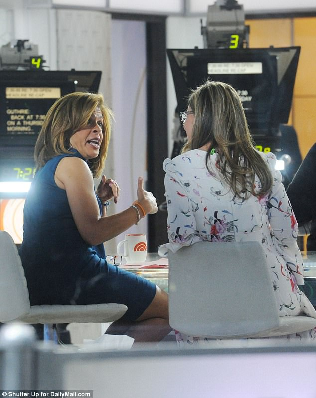 NBC insiders said:'Our team is hurting and the newest member of the team who is yet to prove herself is out and about making public comments that she truly has no knowledge of.' Pictured: Hoda Kotb and Savannah Guthrie on the Today Show on Thursday morning