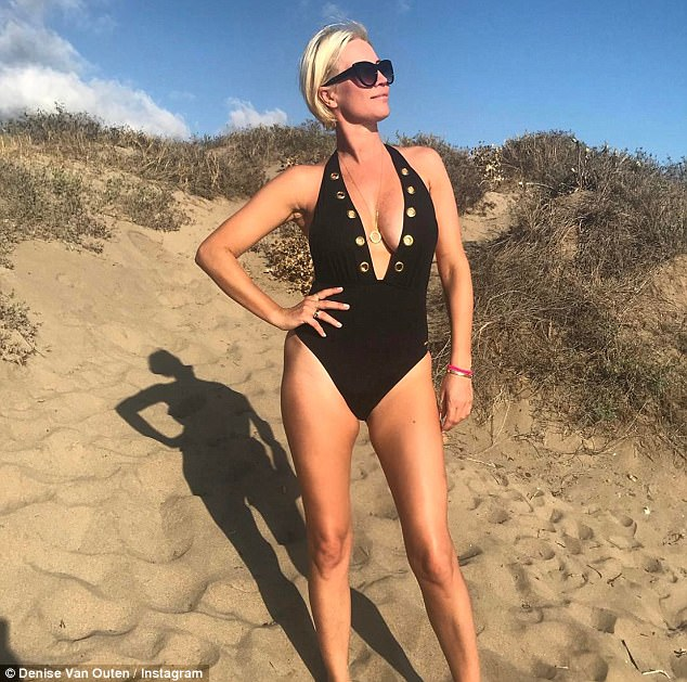 Sizzling: Denise Van Outen, 43, proved she was looking better than ever as she sizzled in a sexy plunging swimsuit that showed off her incredible figure on Tuesday