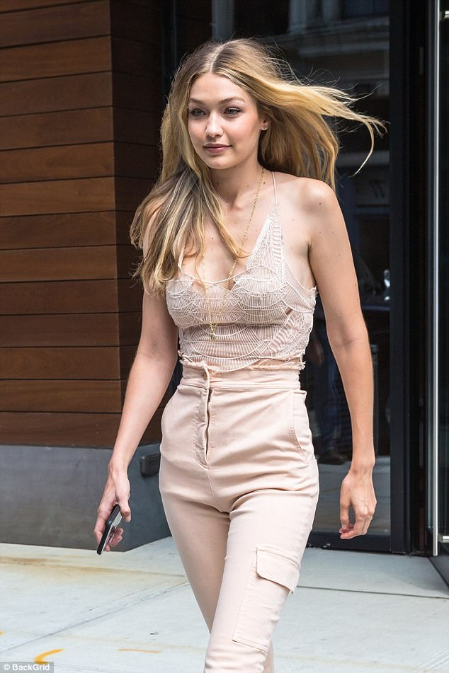 Blonde ambition: The beauty wore her blonde locks in loose waves and accentuated her features with natural make-up