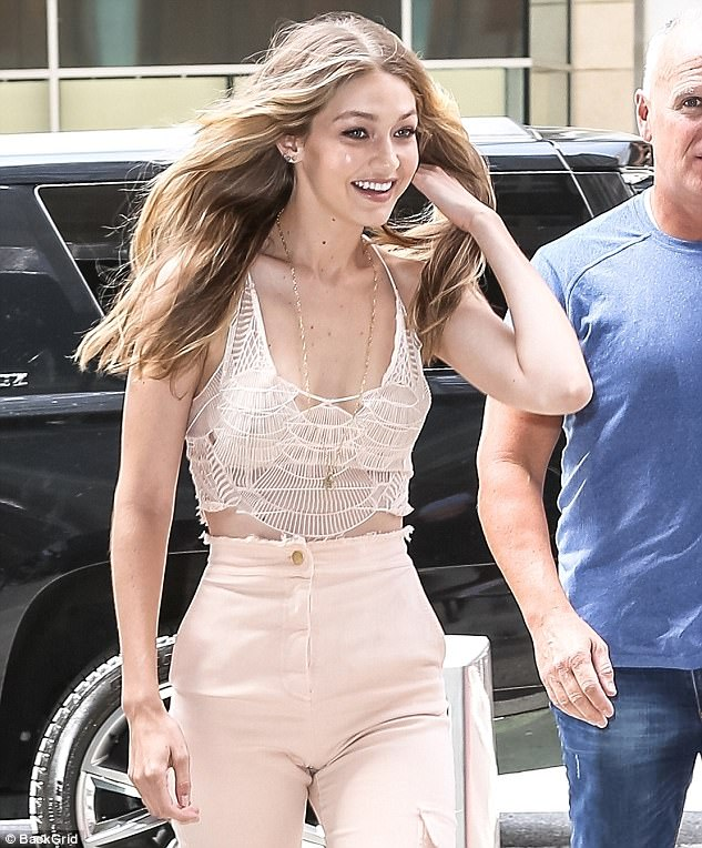 High spirits: Gigidressed to impress for her meeting on Monday, showcasing her incredible figure in a barely-there nude lace crop top