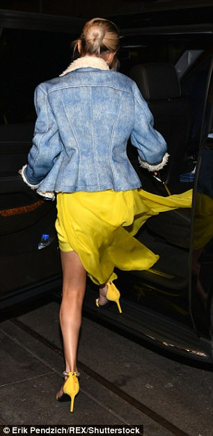 Leggy look: The starlet kept the New York chill out with a shearling-lined denim jacket as she arrived at the event