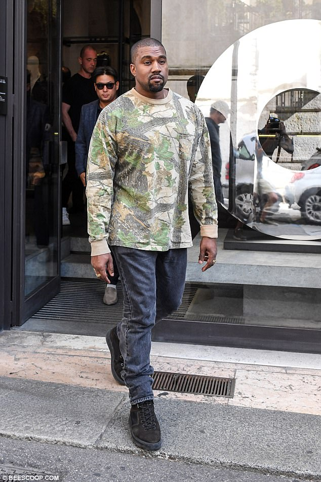 Loved one: Kim's husband, Kanye West, was spotted choosing a sample of fabric during a business trip to Verona, Italy on Tuesday