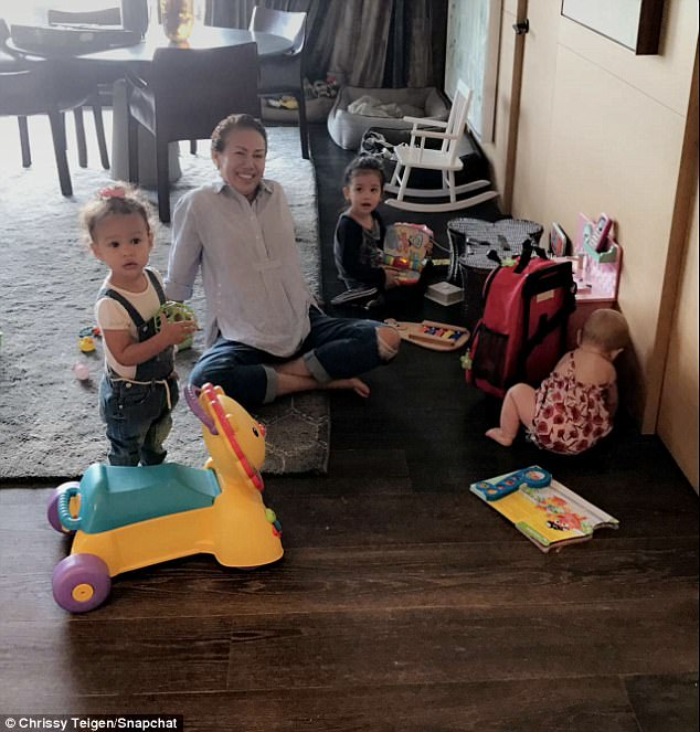 Fun: That same day, Chrissy had a play-date with a pal and two additional children
