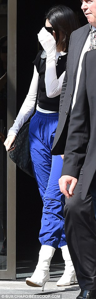 Mismatched:Kendall appeared to have left her catwalk shows in a rush, as she sported casual tracksuit bottoms with a pair of white patent leather boots