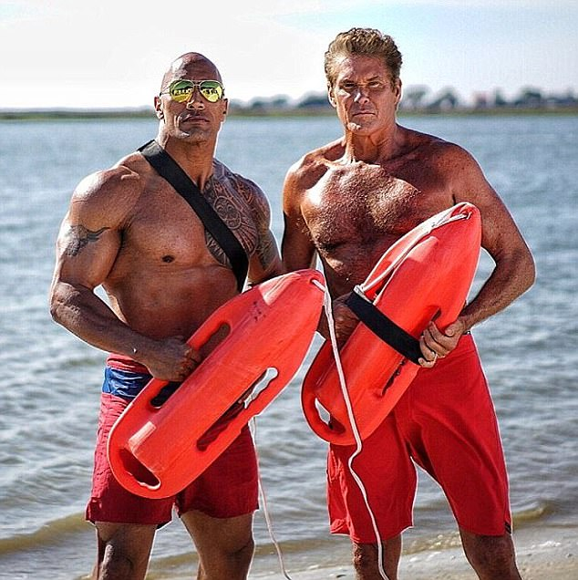 Showing off their pecs appeal: David made a cameo appearance in the rebooted big-screen version of Baywatch with Dwayne 'The Rock' Johnson this year