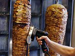 The European Union's legislature is moving to ban the phosphates used in the slabs of meat at the heart of the popular street snack that originated in Turkey. Pictured: A delicious doner being sliced