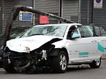 The battered hire car, which belongs to Ubeeqo, was used in the incident in South London last night