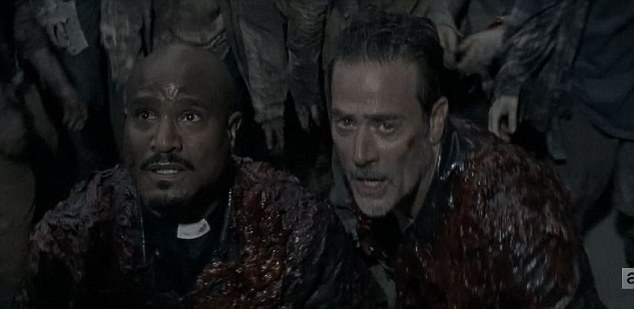 Odd couple: Gabriel Stokes teamed up with Negan during Sunday's episode of The Walking Dead as they escaped a trailer surrounded by walkers