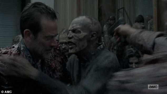 Close call: Walkers hung onto Negan as he and Gabriel left the trailer