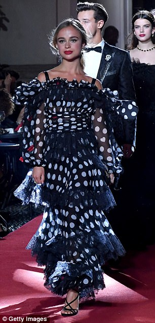Ruffling feathers!Shrouding her lithe frame, the glamorous ball gown featured layers of eye-catching ruffles that culminated in a floor-skimming hemline