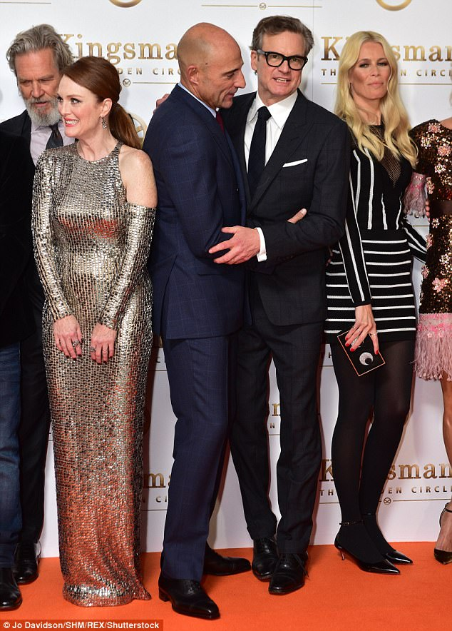 Good to see you: Colin Firth and Mark Strong hugged it out while Julianne Moore chatted with Jeff Bridges