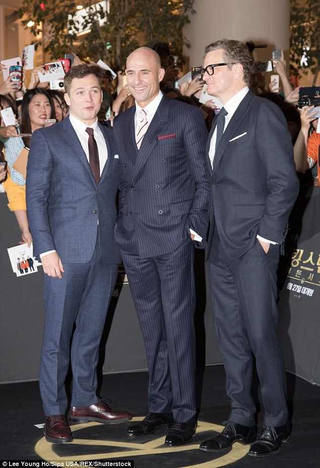 Suited and booted:Colin Firth, Taron Egerton and Mark Strong beamed as they attended the photocall in Seoul