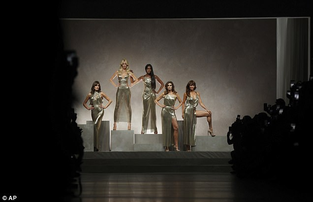 They're back: The models arrived on stage on a platform, before strutting down the catwalk