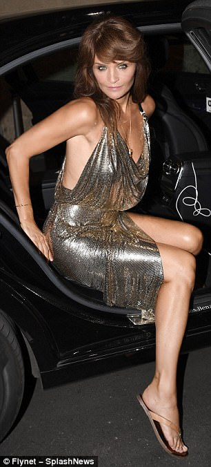 Quite the arrival: Helena switched her towering gold heels for a more comfortable sandal for the after-party