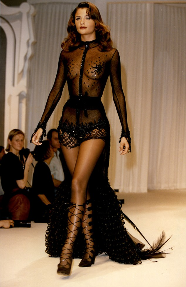 Daring to bare: The catwalk queen often flaunted her enviably lithe physique in semi-sheer numbers. Pictured walking a Chloe show in the Nineties in Paris