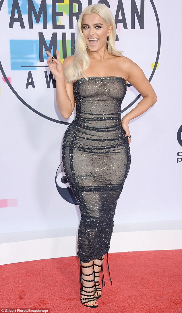 Peace! Bebe Rexha was shining bright in her own right on the red carpet of the American Music Awards at the Microsoft Theatre in Los Angeles on Sunday night