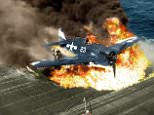 The pilot of a US Navy F6F Hellcat escapes after a crash landing on the USS Lexington aircraft carrier in 1945. Hellcats were credited with destroying more than 5,000 enemy aircraft whiel in service with the US Navy, Marine Corps and the Royal Navy Fleet Air Arm - more than any other Allied naval aircraft. A total of 12,275 were built in just over two years during World War II