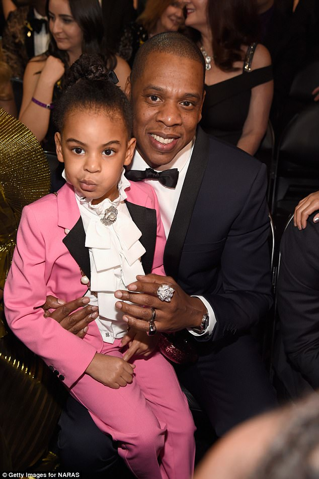 Father and daughter: Jay-Z - who's pictured with Blue Ivy this February - and Beyonce welcomed twins Sir and Rumi