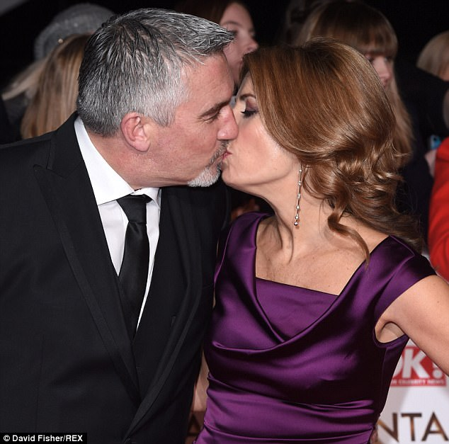 The now-separated couple are pictured kissing at the National Television Awards in 2015