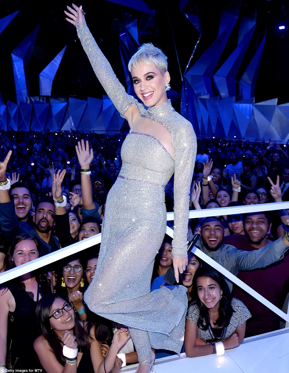 Sparkling star: The Firework singer sparkled in a long grey gown