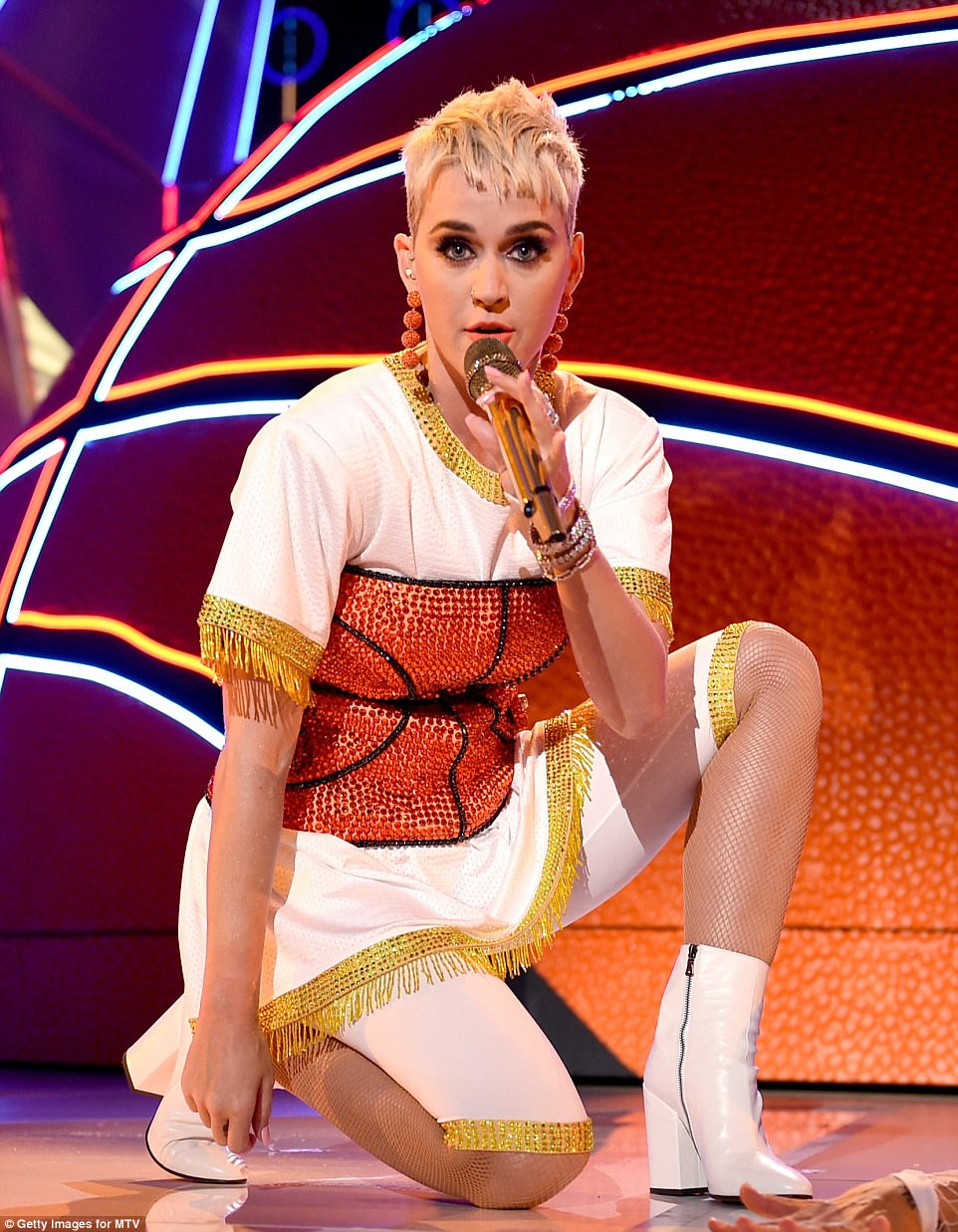 She shoots, she scores! Katy wore a basketball-inspired ensemble for her performance of Swish Swish at the end of the night
