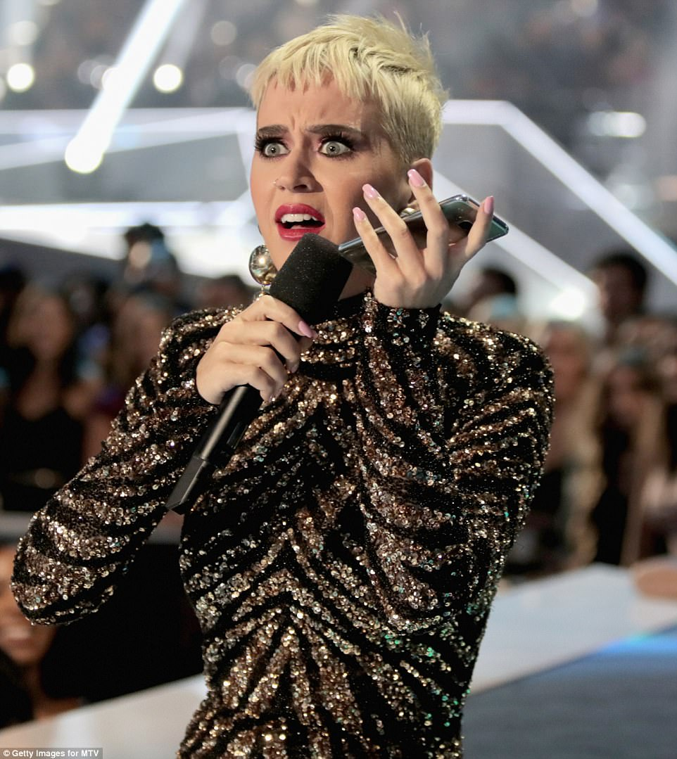 Outfit change:Katy later switched into a black and gold outfit