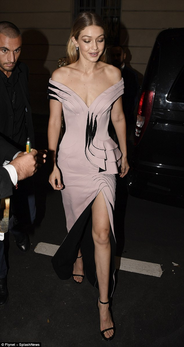 Stunning:The 22-year-old model exuded elegance in a sculpted nude Bardot gown and barely there heels