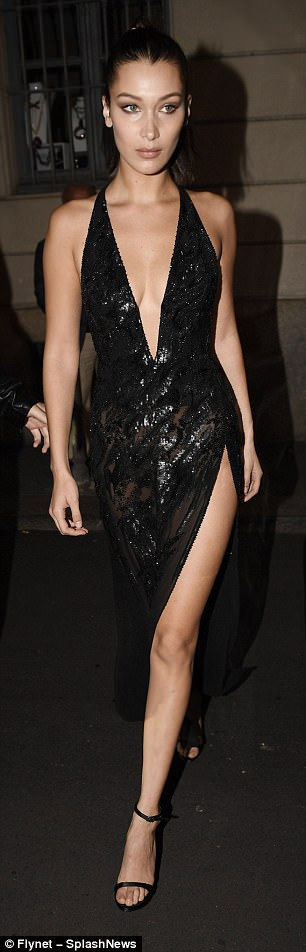 Turning heads:Bella Hadid ensured the Versace after-party was just as memorable as the show, as she stunned in two jaw-dropping ensembles  in Milan on Friday