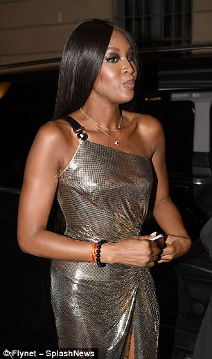 Looking good: She injected a modern twist to her retro look with delicate layered gold necklaces