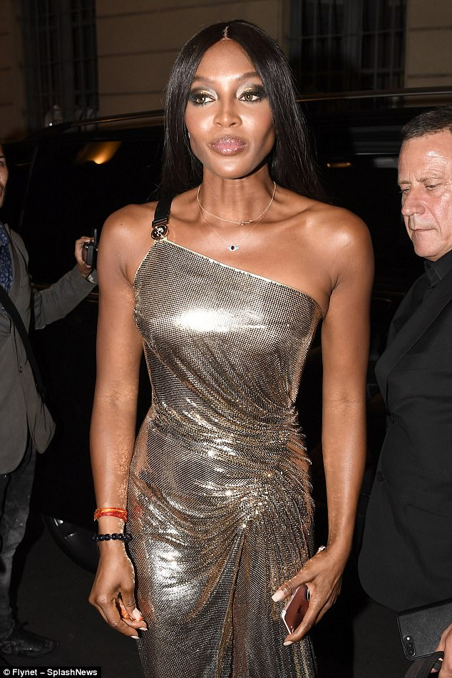 Stealing the show: Naomi put her flawless features on display with eye-catching make-up