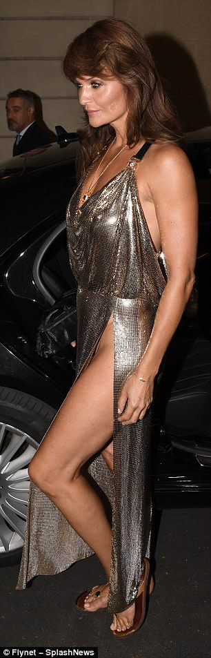 The Midas touch:Looking incredible: The brunette beauty appeared not to have aged at all as she posed in her shimmering gown, flashing her toned legs thanks to the racy thigh-split