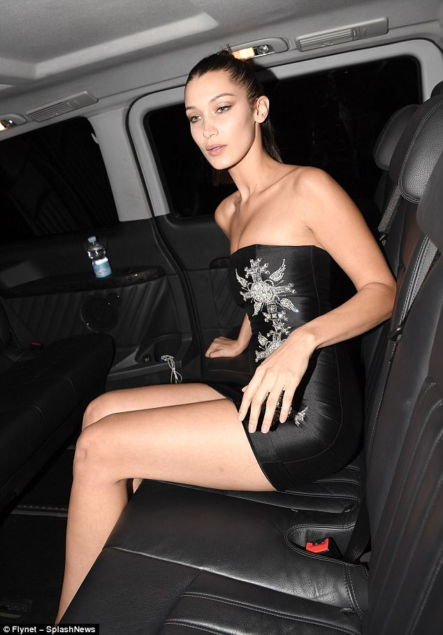 Ready for her close-up:Hadid kept her styling simple, scraping her dark hair back into a severe ponytail and framing her features with understated dewy make-up
