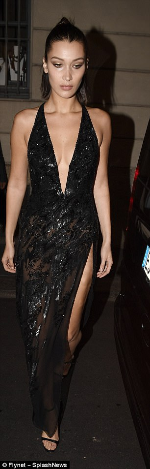 Taking the plunge:The sexy garment boasted a plunging neckline and flashed a peek of the model's toned legs thanks to a racy thigh-split