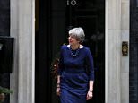The security services believe they have stopped an Islamist suicide bomb plot to assassinate the Prime Minister. She is pictured in Number 10 today