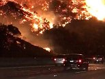 A dramatic 50-acre brush fire erupted Wednesday morning in the Sepulveda Pass area of Los Angeles was captured in this footage