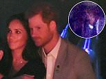 Prince Harry has been caught on camera kissing  girlfriend Meghan Markle on the lips at the closing ceremony of the Invictus Games