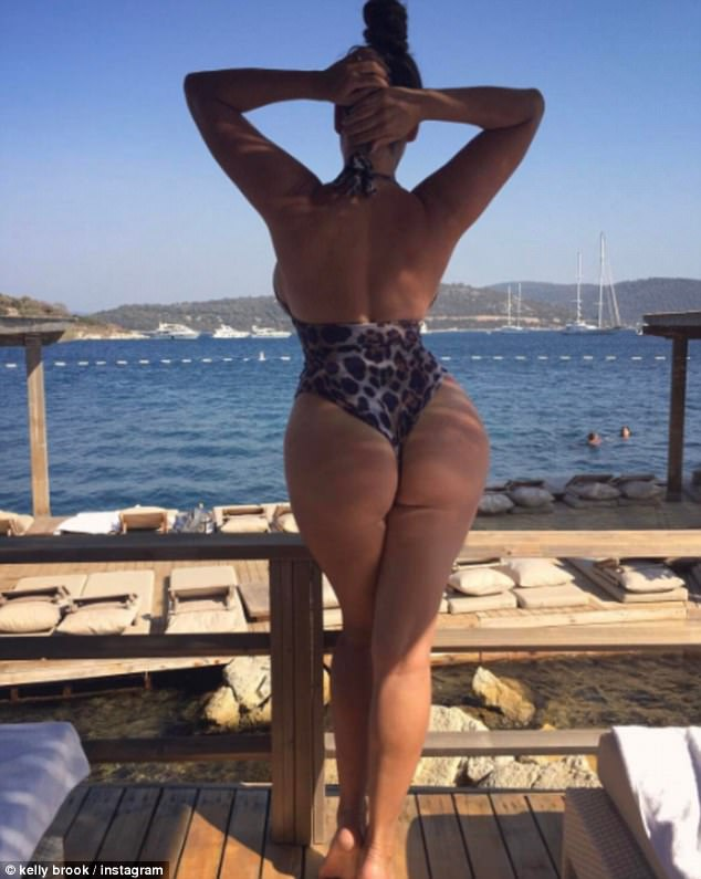 Defiant: Defiantly, Kelly posted another shot, this time flaunting her bodacious behind and peachy derriere