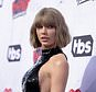 FILE - In this April 3, 2016 file photo, Taylor Swift arrives at the iHeartRadio Music Awards at The Forum in Inglewood, Calif. David Mueller, a former radio DJ who was ordered to pay a symbolic $1 to Swift for groping her at a photo op, says he mailed her a Sacagawea coin last week. Mueller provided a letter to The Associated Press showing the payment was sent Nov. 28, 2017. In a story published Wednesday, Dec. 6, Swift said she hadn't received the dollar. (Photo by Richard Shotwell/Invision/AP, File)