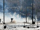 Violent protests have broken out in Bethlehem (pictured) today after US President Donald Trump enraged the Middle East by recognising Jerusalem as Israel's capital