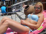 Sarah Bramley relaxes on a sun lounger while on holiday with Michael Lawson in 2016