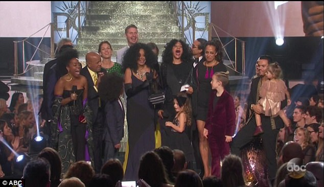 Legendary! The singer and actor debuted his dance moves as Diana Ross came on stage, watched by his giggling daughter